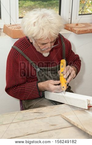 sculptor in his studio engraving a piece of marble