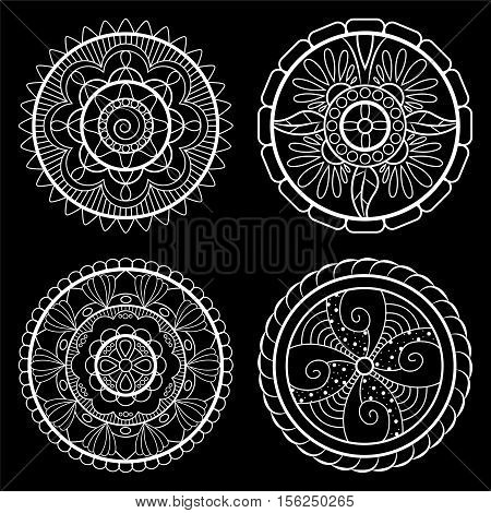 White mandalas on black background. Set of isolated mandalas. Outlined mandala for wedding or web design. Abstract doodle ornament. Oriental mandala. Traditional ornament on chalkboard. Lace doilies