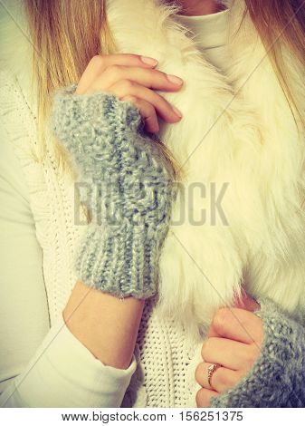 Winter clothing fashion concept. Sensitive female hands with gray gloves. Cozy outfit helps with cold weather outside.