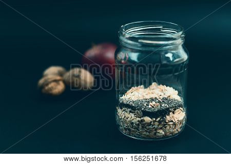 Preparation Overnight Breakfast With Flakes Of Oats, Chia, Apple, Nuts.