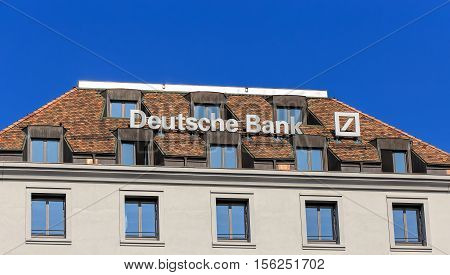 Geneva, Switzerland - 24 September, 2016: Deutsche Bank sign on the top of a building. Deutsche Bank AG is a German global banking and financial services company headquartered in Frankfurt, Geneva is a city in Switzerland.