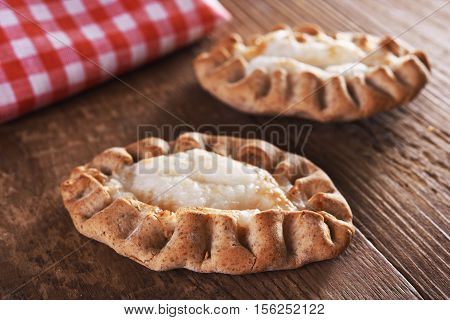 traditional karelian pie over old wooden background