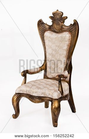 Ancient armchair on a white isolated background