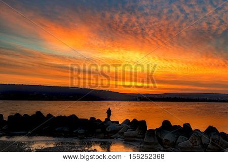 Fishing and fisherman at amazing sea sunset