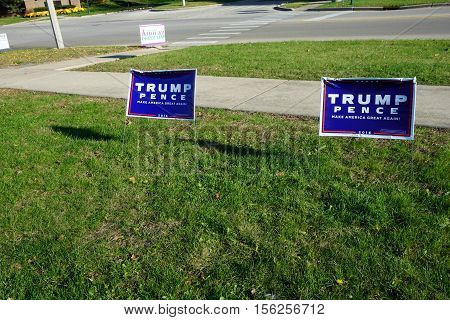 JOLIET, ILLINOIS / UNITED STATES - NOVEMBER 8, 2016: Lawn signs endorse Donald Trump and Michael Pence, with the slogan