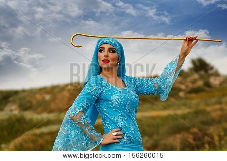 Oriental beauty Sa'idi dance. Nice girl in national costume dancing shepherdess with shepherd's cane outdoors. Nomads.