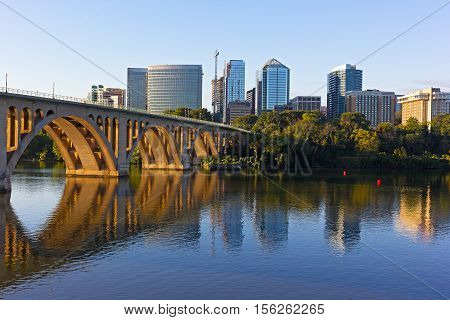 Key Bridge and Rosslyn skyline in early morning Washington DC USA. A view n Potomac River from Georgetown Park in US capital.