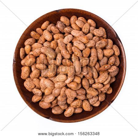 Pinto Beans In Wood Plate Isolated On White Background