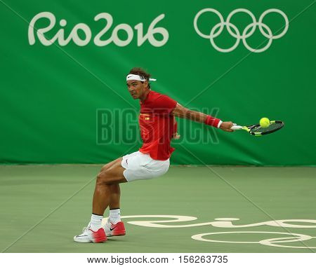 RIO DE JANEIRO, BRAZIL - AUGUST 7, 2016: Olympic champion Rafael Nadal of Spain in action during men's singles first round match of the Rio 2016 Olympic Games at the Olympic Tennis Centre
