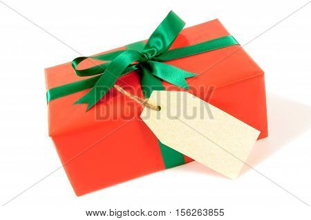 Red Christmas Or Birthday Gift With Green Ribbon Bow, Gift Tag Or Label Isolated On White Background