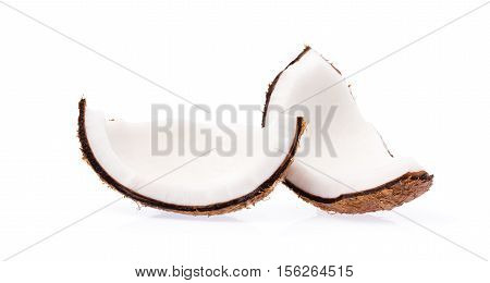 Old Brown Organic Coconut Fruit Copra Broken Into Pieces And Stacked On White Background