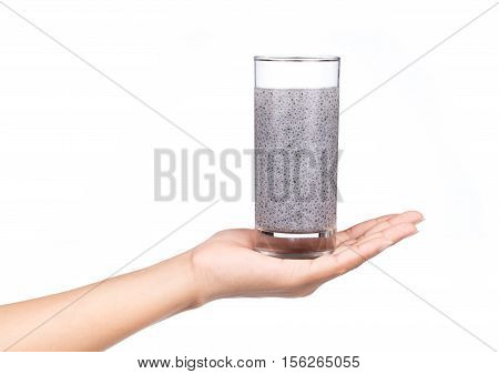 Hand Holding Sweet Basil Seed Drink In Glass Of Water Isolated On White Background.