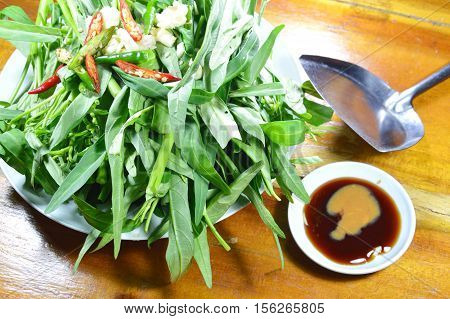 morning glory and sauce with iron flipper prepare to cook