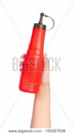 Hand Holding A Bottle Of Tomato Ketchup Isolated On White Background