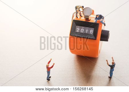 Concept of Happy New year 2017 celebration. Worker on tally counter try to change number 2016 to 2017.