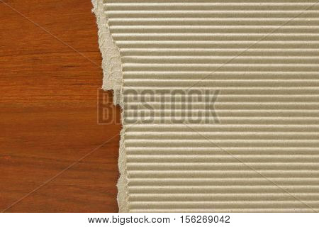 Corrugated paperboard on wood table background .