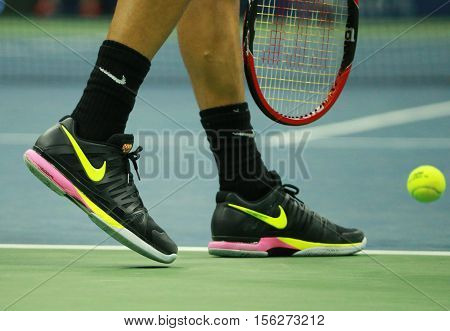NEW YORK - SEPTEMBER 5, 2016: Professional tennis player Grigor Dimitrov of Bulgaria wears custom Nike tennis shoes  during US Open 2016 round four match at Billie Jean King National Tennis Center