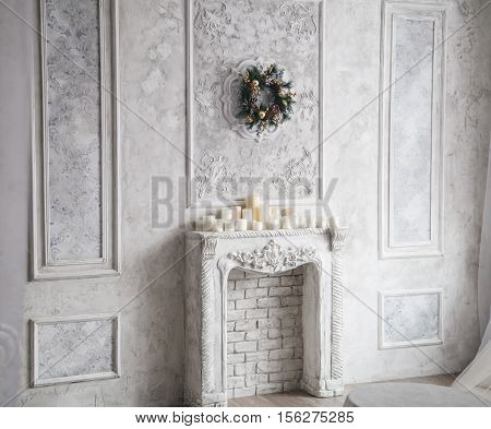 Interior With Grey Fretwork Background, Fireplace And Christmas Wreath.