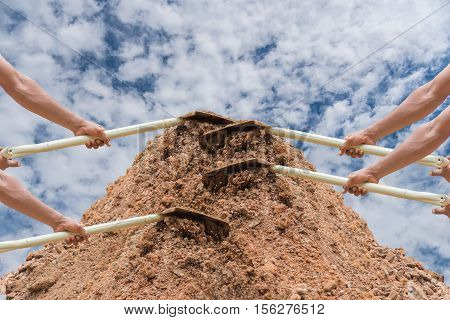 Shovel loader in hand,Shovel loader equipment for construction site,Concept business for team