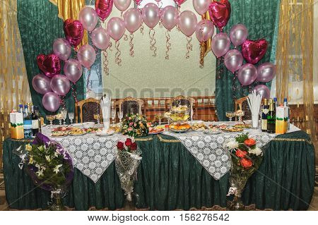 The decorated holiday table for newly married