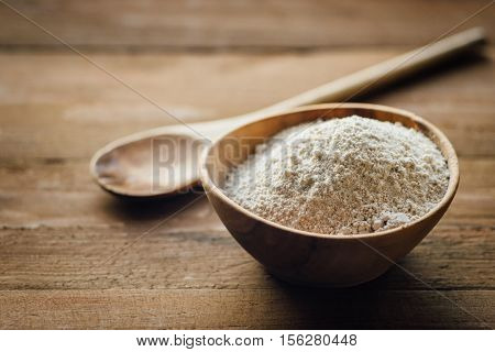 Oat Flour In Old Wooden Bowl