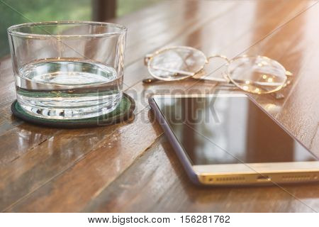 Water Glass Smartphone Glasses On A Wooden Table Selective Focus. Shallow Dof