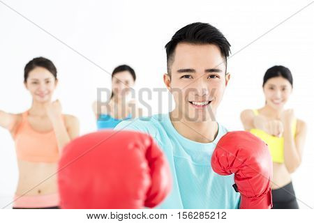 young asian group people in boxing class