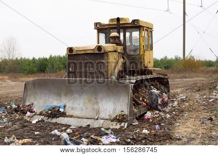 Heavy tracked vehicles generates garbage heap of aborted plastic in landfill outside the city. Waste sorting is required. Lviv city