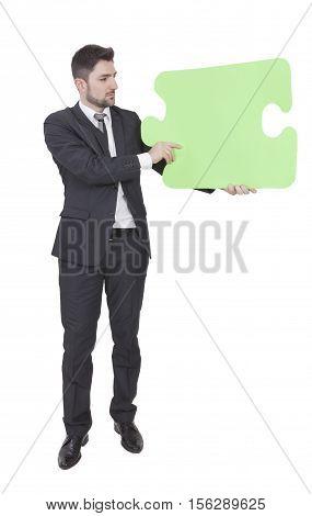 Businessman Keeping Puzzle Piece
