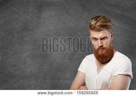 Headshot Of Hipster Fashionable Man With Long Red Beard And Stylish Haircut Having Angry And Unhappy