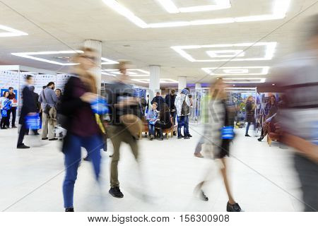 ULYANOVSK RUSSIA OCTOBER 02 2016: The 2nd Russian Informational Forum of robotics and advanced technologies on October 02 2016 in Ulyanovsk Russia. People in motion blur