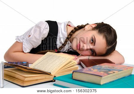 littly schoolgirl studying and looking at the camera isolated on white background