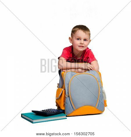 square photo of little schoolboy with schoolbag and calculator isolated on white background