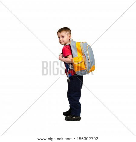 school boy with schoolbag on his back looking at the camera isolated on white background