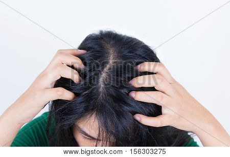 Woman suffering from itching her head Itching scalp.