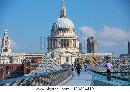 LONDON, UK - SEPTEMBER 10, 2015: St. Paul cathedral and millennium bridge