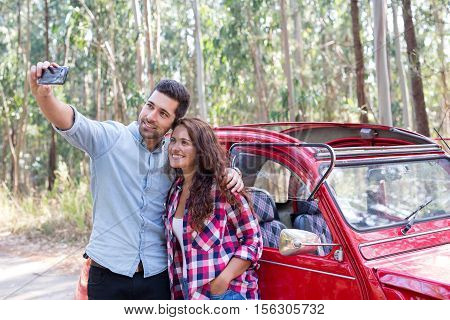 Beautiful young couple on roadtrip through countryside