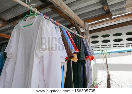 Dry cloths and T-Shirt hang on the clothesline
