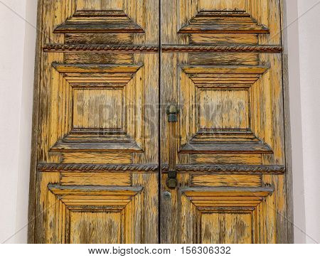 Wooden door at old house in Moscow Russia. Closed up.