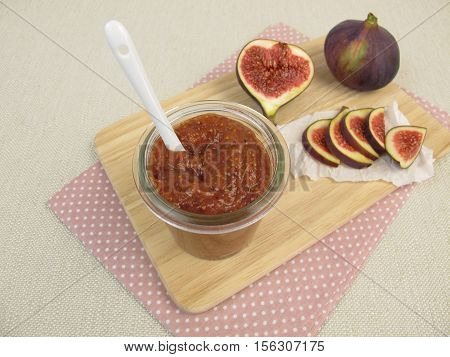 Homemade fig mustard in jar and fresh figs