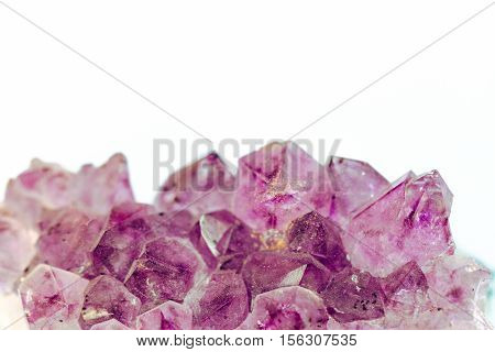 Purple Amethyst precious stone on white background