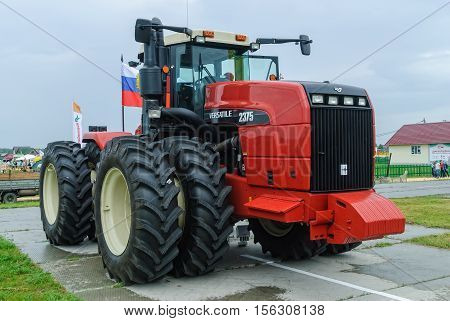 Tyumen, Russia - June 24, 2016: The 5th open championship of Russia on a plowed land. Tractor demonstration on platform open-air