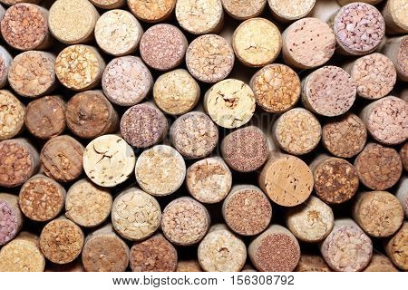 Background of used wine corks. Wall of many different wine corks. Closeup of wine corks.