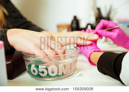 Manicure procedure with female hands.