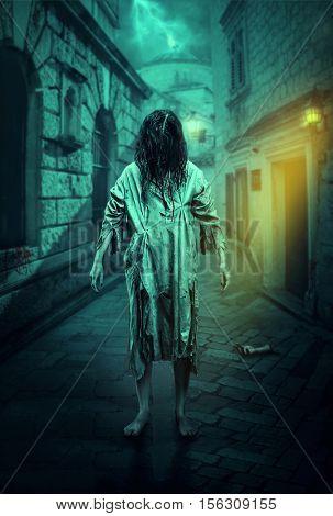 Horror zombie on the street. Halloween.