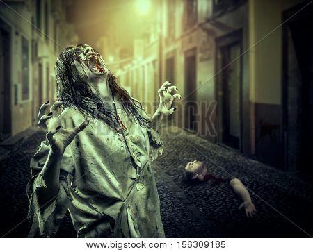 The horror shouting zombie girl on the dark street