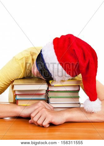 Student in Santa Hat sleep on the Books at the Table