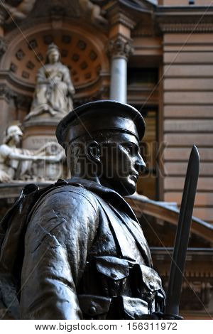 Sydney Australia - Oct 16 2016. Detail of the Sailor statue with the General Post Office in the background which guarding the cenotaph at Martin Place Sydney Australia.