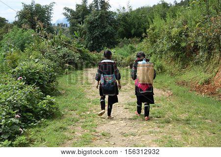Black Hmong Minority women in a village near Sapa in Vietnam