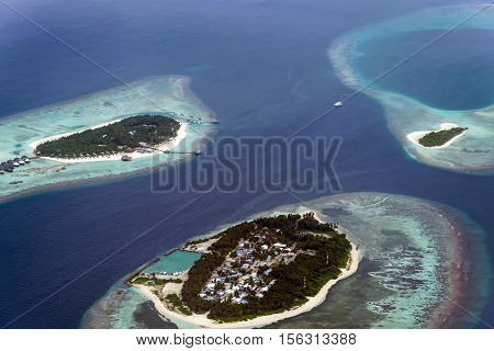 Scene shot on the seaplane flight from Male to Meedhupparu island showing the islands in the middle of the indian ocean surrounded by unique turquoise water.